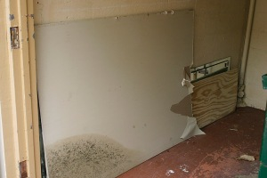 Breakdown sheetrock and deposit into dumpster. Ask Board Member to unlock dumpster door.